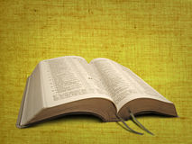 New world open bible. Photo of open bible set against a canvas parchment material background ideal for text etc Royalty Free Stock Photos
