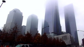 New World Trade Center covered by clouds on a misty day USA cityscapes stock video
