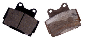 New and worn brake pad. Isolated on background Royalty Free Stock Photo