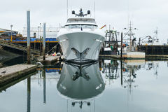 New yacht in marina. New luxury yacht docked in Westport marina among working fishing boats while awaiting sea trials before delivery to customer Stock Photography
