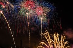 New year's eve fireworks in dark sky. Colourful fireworks in dark sky Stock Photography