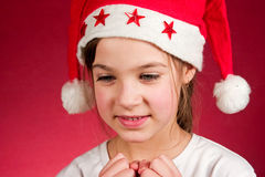 New year. Cute little girl and santa claus hat Stock Photo