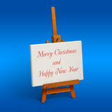 New Year. Little wood easel and white canvas royalty free stock photos