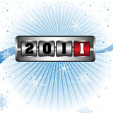New Year. Abstract colorful design with snowflakes and the number 2011 written in a metallic slot machine, symbolizing the passing into the next year Royalty Free Stock Photos