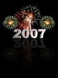 New Year 2007. Fireworks with chrome bevelled 2007 face on with mirror reflection Royalty Free Stock Photography