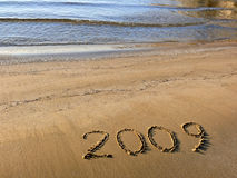 The new year 2009. Written on the sand stock photo