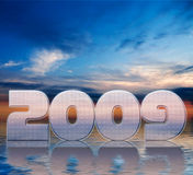 New year 2009. The 2009 New Year in chrome-look in sunset background stock illustration