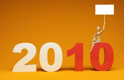 New Year 2010. Numbers of new year 2010 with small figure holding a banner for your messages. Realistic 3d render Royalty Free Stock Image