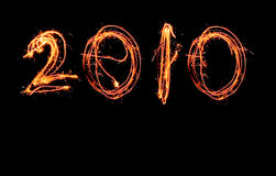 New year 2010 in sparklers. 2010 written with sparklers in one line on a black background Royalty Free Stock Images