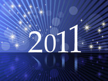 New Year 2011. Blue background with stars and rays for New Year's Eve 2011 Royalty Free Stock Photography