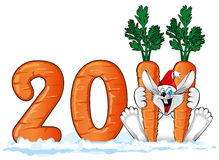 New year 2011 : Happy Rabbit with a large carrot. Happy Rabbit in Santa hat with a large carrot (symbol of the new year 2011 Stock Photography