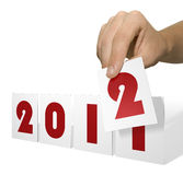 New-Year 2012. Hand holds calendar card for change of date Stock Photography