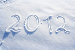 New year 2012. The number 2012 written in snow Royalty Free Stock Photo