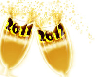 New Year 2012. Cups toasting the new year. 2012 celebrations Royalty Free Stock Images