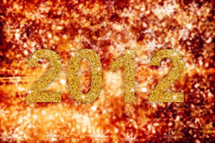 New year 2012. 2012 with abstract gold sparkling background Stock Photography