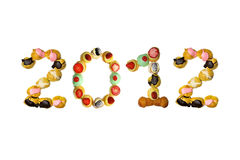 New year 2012. Concept with italian pastry on a white background Stock Image