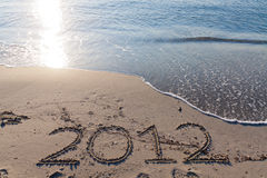 New year 2012 on the beach. Written on the sand Stock Photo