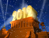 New Year 2012 celebration. Concept: shiny golden 2012 on pedestal in a snowy weather Royalty Free Stock Photography
