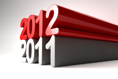 New year 2012 stands on 2011 Stock Photography