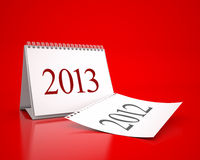 New Year 2013 Calendar. 3D desktop calendar 2013 and 2012 in red background Stock Photo