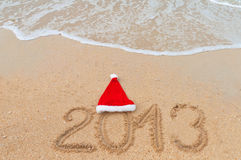 New year 2013 and Christmas beach vacation. And holiday concept. 2013 written on tropical beach sand Stock Photos