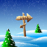 New Year 2013 illustration. Illustration of wooden arrows in the snow pointing back to 2012 and forward to 2013 royalty free illustration