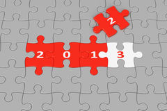 New Year 2013 made from puzzles. New Year 2013 made from red and white puzzle pieces, 3d rendering royalty free illustration