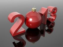 New year 2013 in numbers with a christmas ball. On a reflective black surface Stock Photo