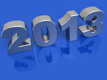 New year 2013 silver. New year 2013 in silver over a blue background Stock Photo