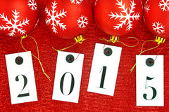 New year 2015 on tags and Christmas balls Stock Image