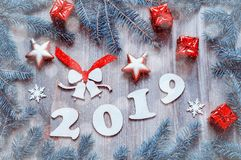 New Year 2019 Festive Background With 2019 Figures, Christmas Toys, Blue Fir Tree Branches And Snowflakes Stock Photography