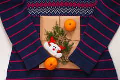 New Year 2020 Flatlay. Christmas Blue And Pink Ornamental Sweater, Gift Box In Eco Kraft Paper,pine Tree.Winter Holidays Royalty Free Stock Photo