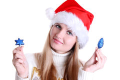 New year. Young woman in santa hat  choice decoration Stock Photos