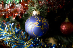 New Year. The big dark blue sphere with drawing on a New Year's tree Stock Images