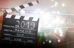 New year 2019 abstract film and destiny concept on blured background with clapperboard. New year 2019 abstract film and destiny unique concept on blured stock photography