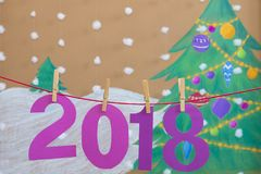 2018 new year. against the background of a painted Christmas tree and snow stock photos