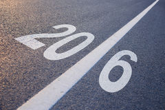 New Year 2016 Ahead. Closeup photo of New Year 2016 Ahead concept on the road stock photos