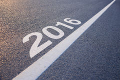 New Year 2016 Ahead. Closeup photo of New Year 2016 Ahead concept on the road stock image