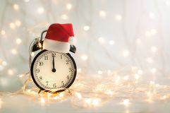 New Year alarm clock showing midnight time royalty free stock photo
