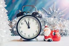 New Year alarm clock with Santa Claus stock photo