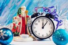 New Year alarm clock with Santa Claus and Snow girl Royalty Free Stock Photography