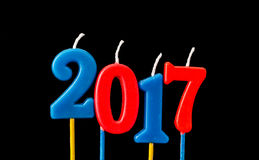 New year 2017 - Alphabet anniversary candles in 2017 Stock Photography
