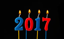 New year 2017 - Alphabet anniversary candles in 2017 Royalty Free Stock Image
