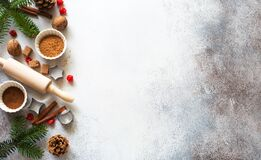 New Year An Christmas Stone Background With Baking Ingredients, Fir Twigs And Cones Royalty Free Stock Photos