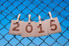2015 New Year antique parchment paper. Sign in front iron cage blue sky background Stock Photos