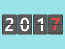 New Year arrival 2017. Happy New Year 2017 mechanical scoreboard congratulation, flip symbol on blue background. New year, happy and christmas concept. Flat Royalty Free Illustration