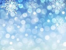 New year background blue. Glitering bokeh lights and snowflakes, christmas snow background Royalty Free Stock Photography