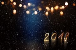 New year background with blue light beam and golden bokeh. For a congratulations card stock images