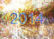 New year 2014. On a background of blurred bright fireworks Royalty Free Stock Image