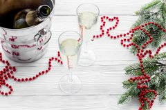 New Year 2018 background. Champagne in bucket, glasses with beverage, spruce branch and decoration on grey background Stock Image